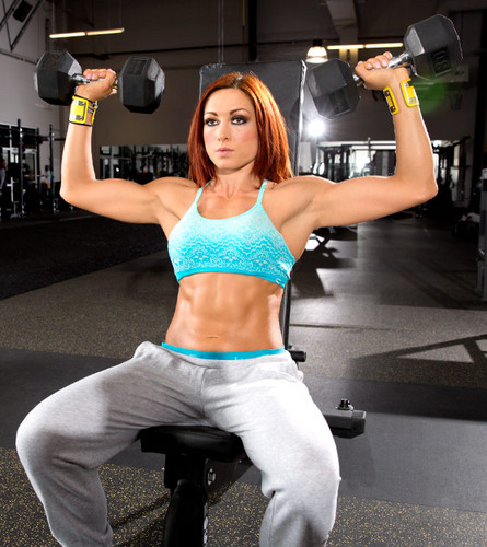 WWE Divas achtergrond containing a halter and a barbell titled Becky Lynch