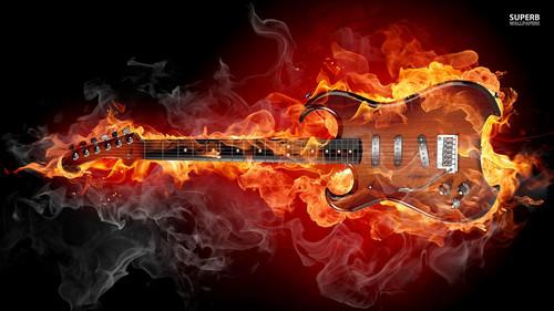 Heavy Metal karatasi la kupamba ukuta containing a moto entitled Flaming guitar, gitaa