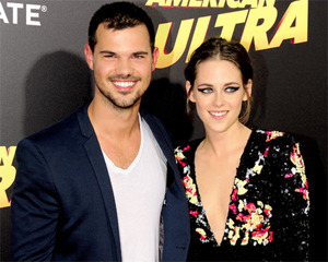 Kristen with Twilight co-star,Taylor Lautner at American Ultra premiere