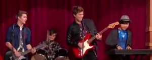 Max and his band playing at the talent show