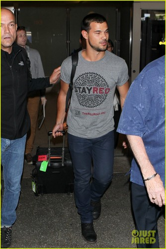 Taylor Lautner wallpaper probably containing a workwear titled Taylor Lautner Shows Support for Native American Culture