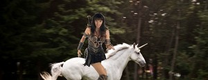 Xena riding an beautiful unicorn