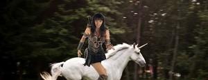 Xena riding an beautiful unicorn