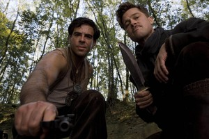 Eli Roth as Sgt. Donny Donowitz and Brad Pitt as Lt. Aldo Raine