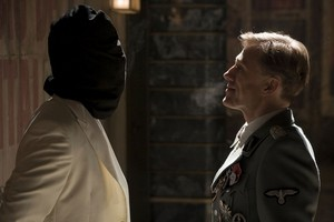 Brad Pitt as Lt. Aldo Raine and Christoph Waltz as Col. Hans Landa