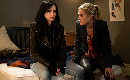 Netflix fond d'écran with a well dressed person, a business suit, and a hip boot titled First photos of Marvel's 'Jessica Jones'
