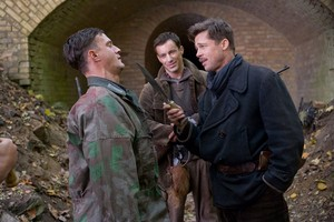Sonke Mohring as Pvt. Butz, Gedon Burkhard as Cpl. Wilhelm Wicki and Brad Pitt as Lt. Aldo Raine