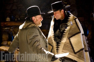 Walton Goggins as Sheriff Chris Mannix and Tim Roth as Oswaldo Mobray in The Hateful Eight