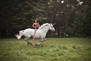 Wonder Woman rides on her Beautiful Unicorn