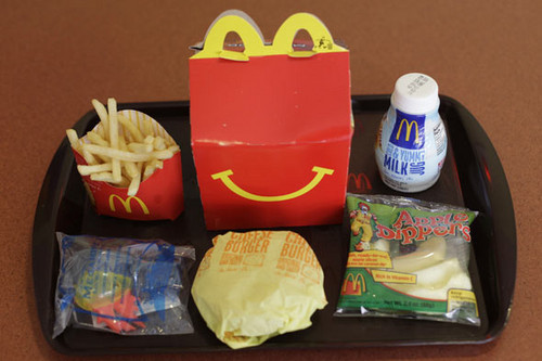 McDonald's wallpaper possibly with a lunch and a canned food called happy meal