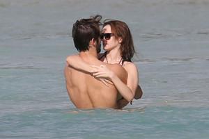 "Emma and Matt Janney on a ""sun-kissed Caribbean beach"""