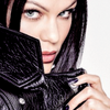 Jessie J photo probably with an overgarment, a cloak, and a box coat called American Way