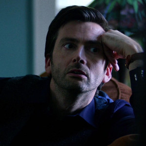 David Tennant as Kilgrave in a room