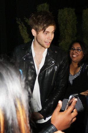 Luke leaving J B's AMA's after party at the Nice Guy