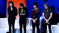 Moment of silence out of respect for the events in Paris at the start of the 1D London Session - one-direction photo