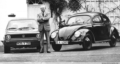 Volkswagen fond d'écran probably containing a minicar, a hatchback, and a rue entitled Ferry Porsche with the Golf MK1 and Kdf Wagen