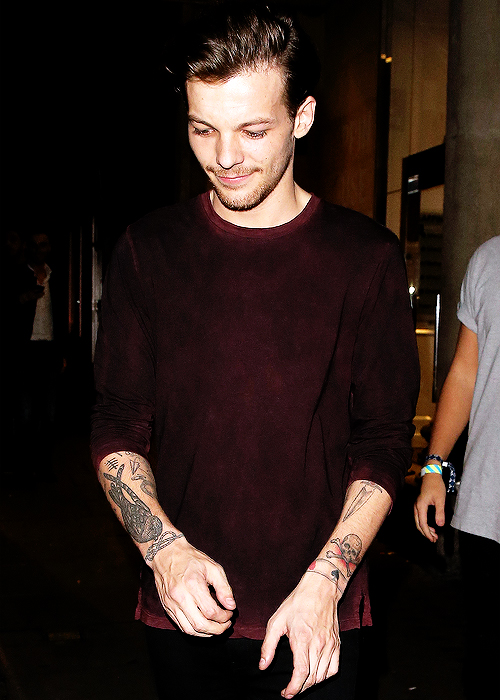 Louis leaving the London Edition hotel
