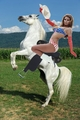 Myra Breckinridge rides her beautiful white corcel