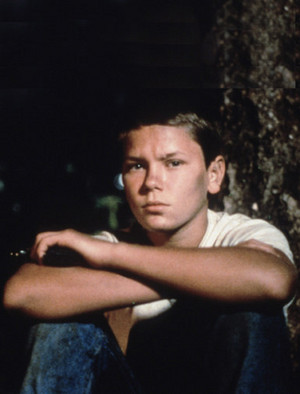 River Phoenix as Chris Chambers in Stand door Me