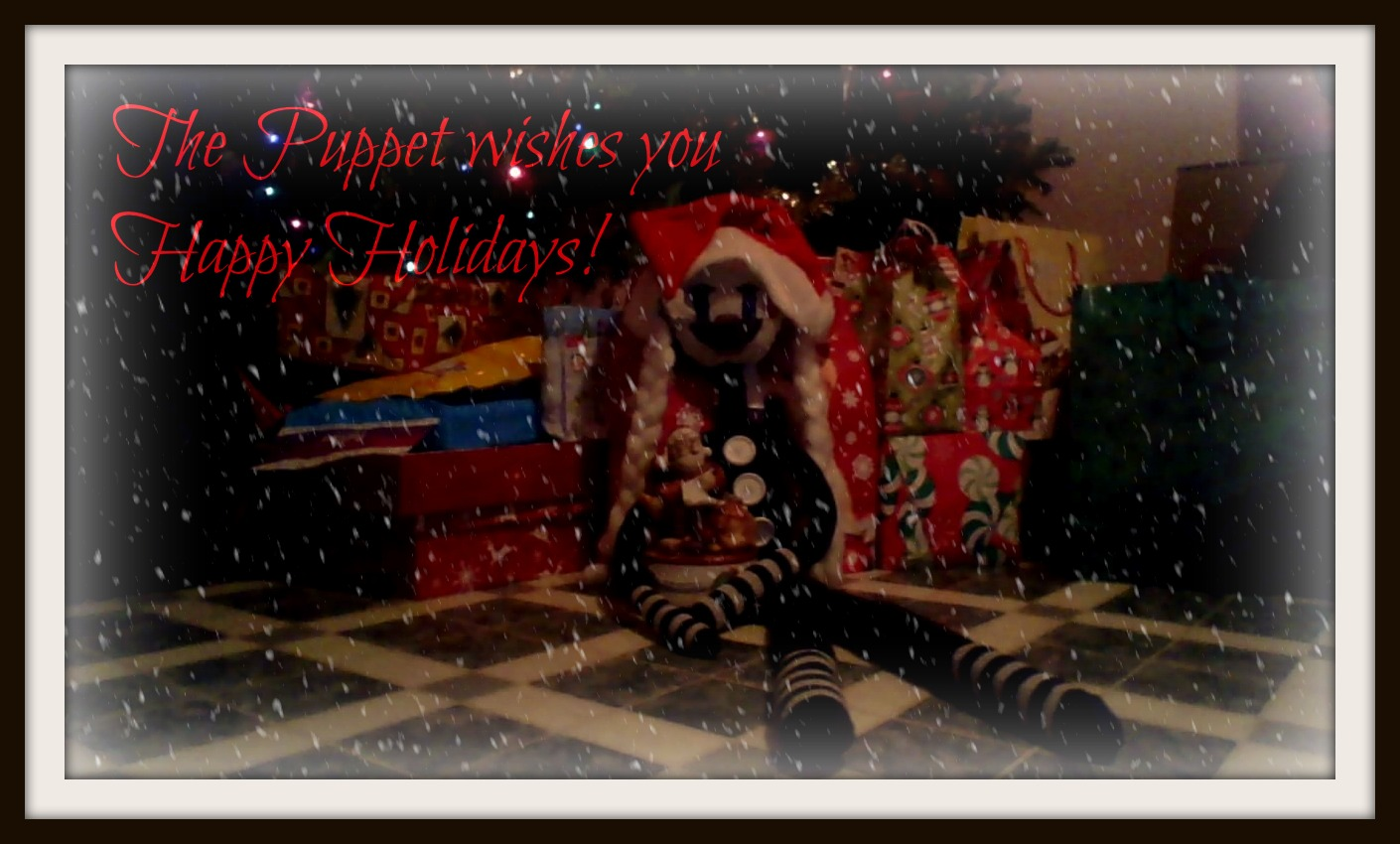 The Puppet wishes Ты Happy Holidays