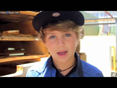 MattyB Hintergrund possibly containing a Fernsehen receiver, a fedora, and a sign called image