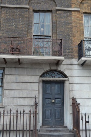 Kreacher peeking out the window at 12 Grimmauld Place