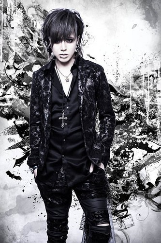 Nocturnal Bloodlust wallpaper with a well dressed person and an outerwear called Masa