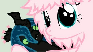 Fluffle puff holding a voodoo doll chrysalis