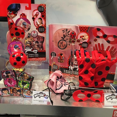 Miraculous Ladybug Hintergrund probably with a hard Süßigkeiten and a süßwaren, konditorei called Miraculous Ladybug compact communicator and role play set