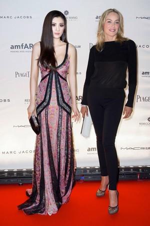 Rebecca Wang and Sharon Stone at amfAR's Inspiration Paris 2012