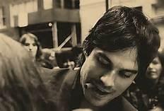 Ian signing an autograph