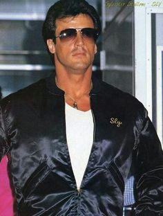 Sylvester Stallone wallpaper probably containing a well dressed person, an outerwear, and a box coat titled Sylvester Stallone