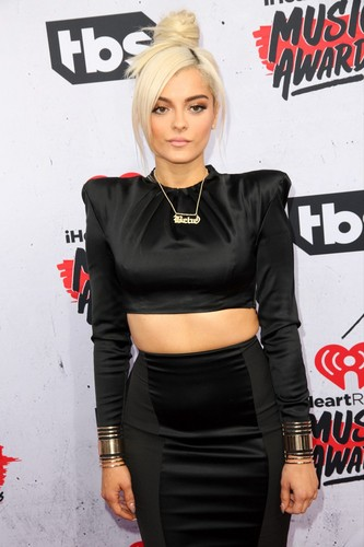 Bebe Rexha Hintergrund possibly with a hip boot, a well dressed person, and a legging entitled at awards
