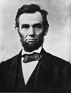 The Presidents of The United States wolpeyper probably with a business suit entitled Abraham lincoln The First Assainated President