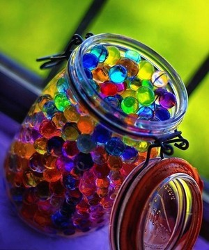 Colorful beads in a jar