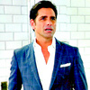 John Stamos 写真 possibly with a well dressed person and a business suit called Grandfathered