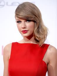 Taylor in a red dress