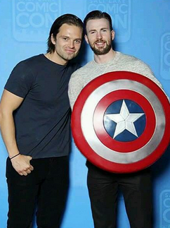 Chris Evans & Sebastian Stan wallpaper possibly containing a shield entitled Sebastian Stan and Chris Evans