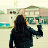 Wynonna Earp photo probably with an overgarment, a hip boot, and a box coat called Wynonna Earp