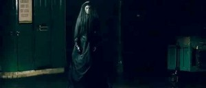 at the train station the woman in black 31303283 640 274