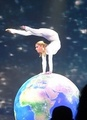 Contortionist performing on globe