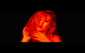 Gigi in Calvin Harris' How Deep Is Your Amore Musica Video