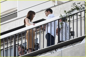 Jamie Dornan and Dakota Johnson kiss Overlooking the Eiffel Tower