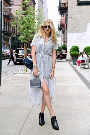 Le Fashion Blog Model Off Duty Street Style Gigi Hadid Striped Shirtdress Tort Sunglasses
