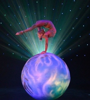 Same contortionist performing on same ball
