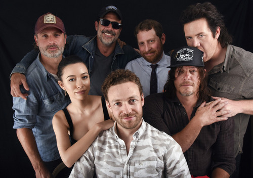The Walking Dead achtergrond probably with a business district titled The Walking Dead Cast @ Comic-Con 2016