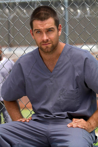 Antony Starr wallpaper with a chainlink fence titled Antony Starr as Lucas cappuccio in 'Banshee'