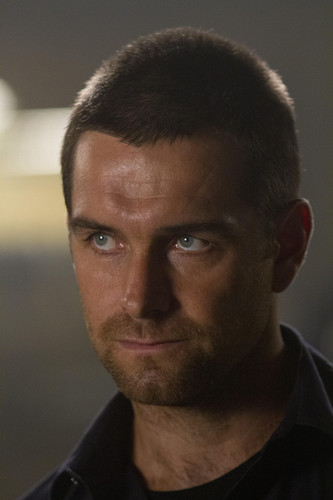 Antony Starr wallpaper possibly with a business suit and a portrait called Antony Starr as Lucas capuz, capa in 'Banshee'