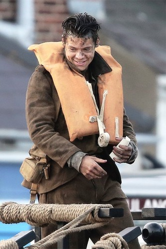 Harry Styles wolpeyper probably containing a green birete entitled Harry Styles on the set of Dunkirk