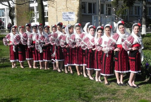 romanian people. romania achtergrond probably containing a muzikant, bandlid titled romanian women traditional dress people port